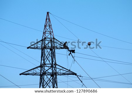 Electric power transmission line construction - stock photo