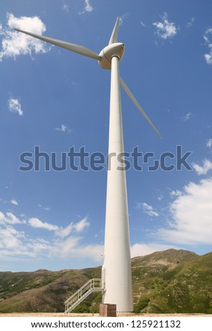 Electric Power Windmill and Blue Sky - stock photo
