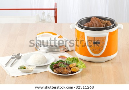 Electric pressure cooker new technology for cooking - stock photo