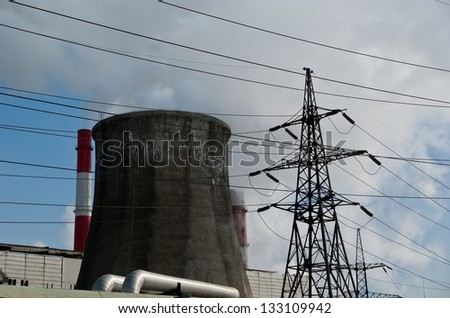 electric pylon and  pipes of coal  burning power station - stock photo