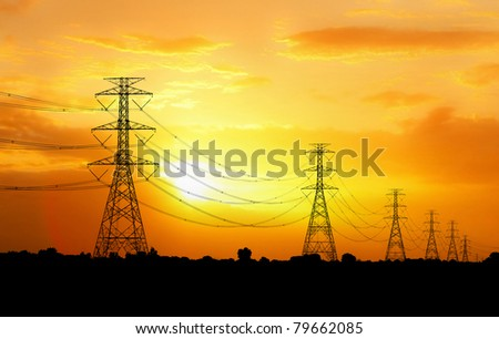 electric pylon at sunset - stock photo