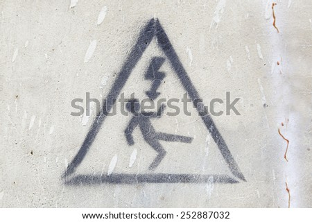 Electric signal danger, detail of an information signal, danger and death - stock photo