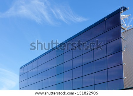 Electric solar panel on factory building wall