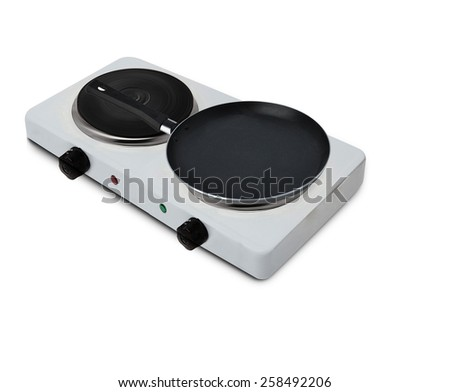 Electric stainless steel stove with pan - stock photo