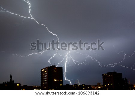 Electric strokes above the city - stock photo