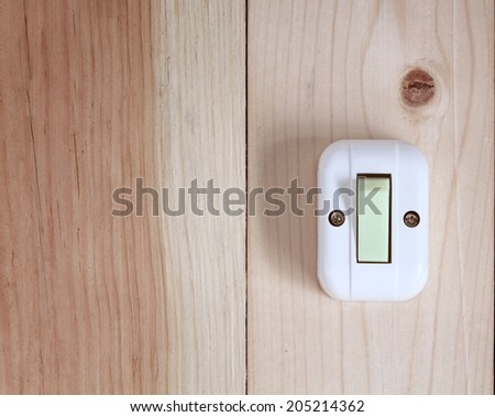 electric switch on wooden wall - stock photo