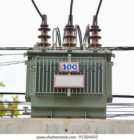 Electric transformer on some power concrete pole. - stock photo