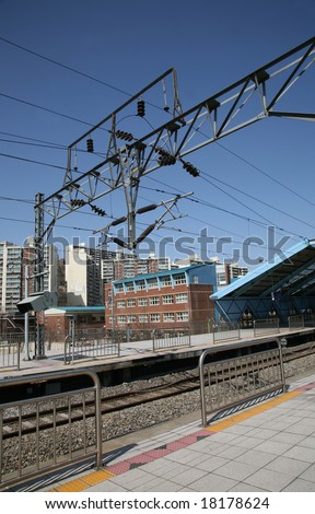 Electric Transformers which power subway train against beautiful blue sky