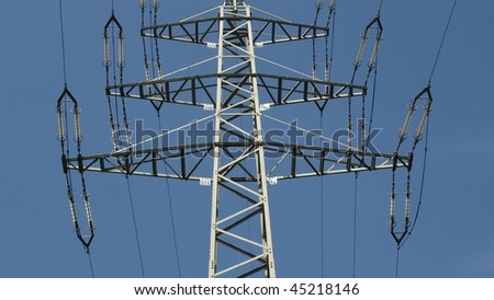 Electric transmission line tower mast with wires - (16:9 ratio) - stock photo