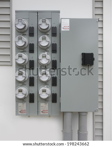 Electric utility meters for an apartment complex - stock photo