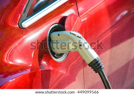 Electric vehicle charging. EV charge port and quick charging socket. Charge port of electric car - stock photo
