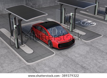 Electric vehicle charging station in public space. The charging spot support by solar panels, storage batteries. - stock photo