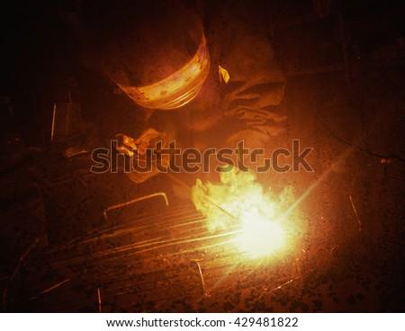 Electric Welder weld metal. - stock photo