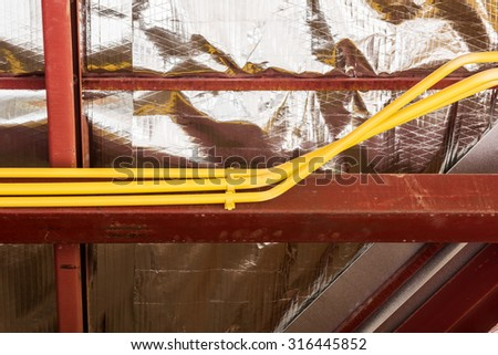 Electric wires installation and pipes of electricity in new house construction site. - stock photo