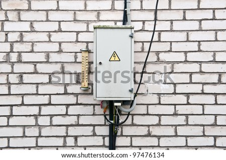 Electrical box on the brick wall - stock photo