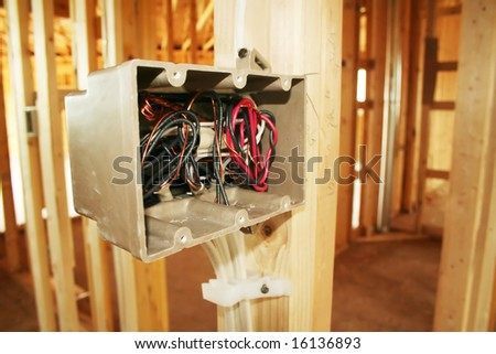 Electrical box with wiring in a new home under construction - stock photo