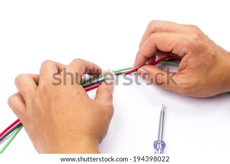 electrical cable jointing using connector on isolated background - stock photo