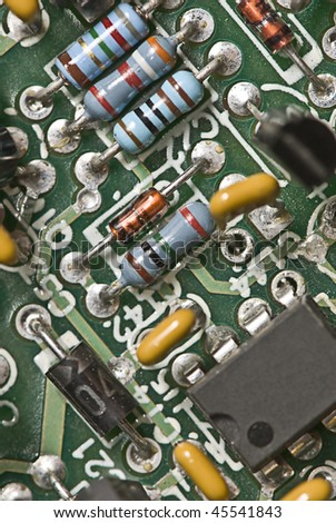 Electrical components on a printed circuit board - stock photo