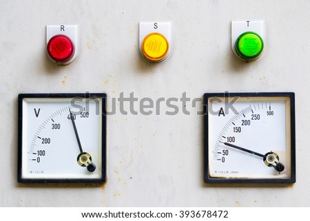 Electrical control cabinet with amp and volt meter - stock photo
