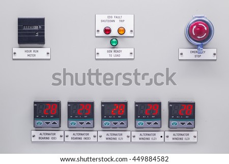 Electrical control panel containing has a digital temperature gauge with an emergency push button switch shutdown . - stock photo