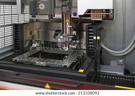 Electrical discharge machine spark eroding with wire - stock photo