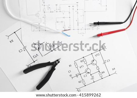 Electrical drawings with tools, top view - stock photo