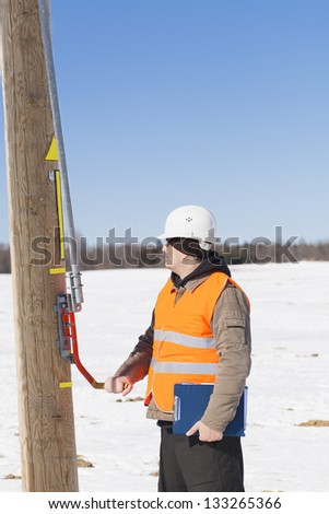 Electrical engineer inspect electric line dis connector - stock photo