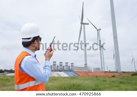 Electrical engineers working at wind turbine power generator station