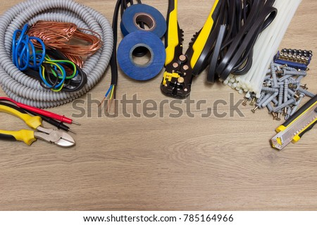 Electrical EquipmentElectrical Tools And Power Cables For Installation Network ConnectionWooden Background