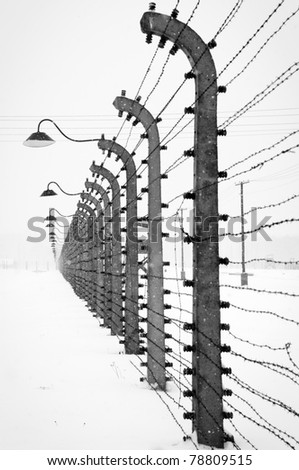Electrical fence around Auschwitz concentration camp - stock photo