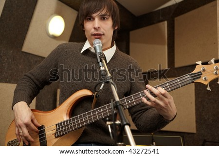 electrical guitar player playing and singing. practice - stock photo