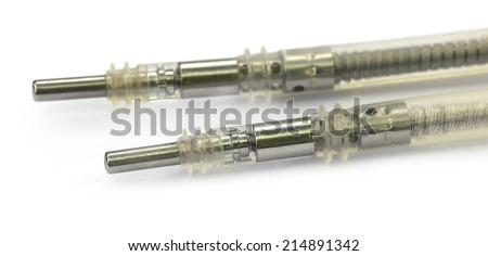 Electrical Leads of a Pacemaker over white background - stock photo