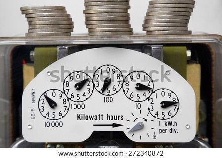 Electrical Meter with Money.A simple and universal way of showing the cost of electricity. - stock photo
