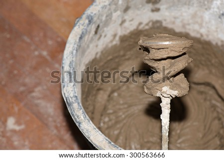 Electrical mixer during the work with plaster - stock photo
