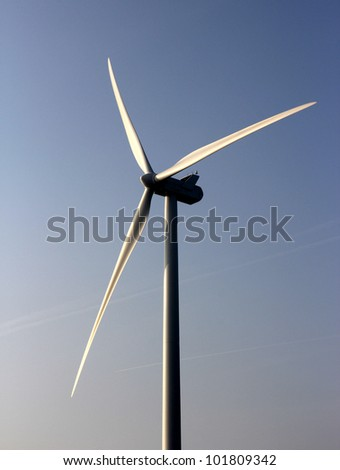 Electrical power generating wind turbine. - stock photo