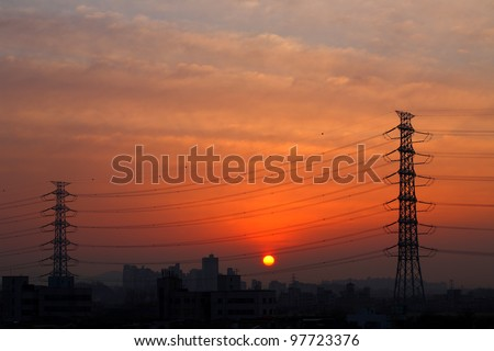 Electrical power lines  at sunrise - stock photo