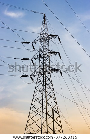 electrical power post at sunset background