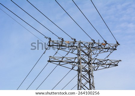 Electrical powerlines against a background of the sky - stock photo