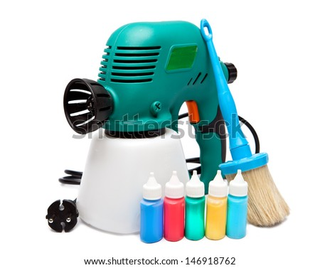 electrical spray gun for coloration, for color pulverization and a paintbrush and small bottles with color - stock photo