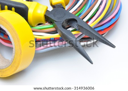 Electrical tools and cables on metal surface - stock photo