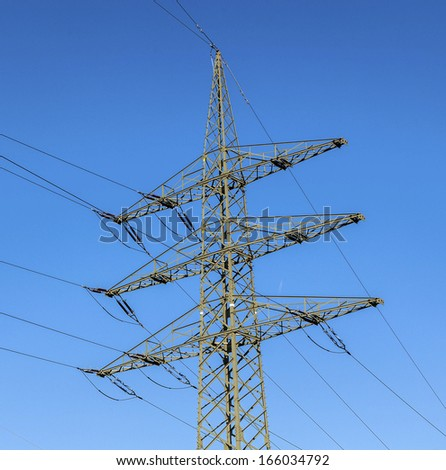 electrical tower in beautiful landscape with sky - stock photo
