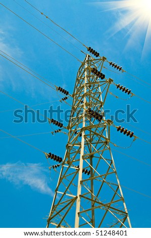 Electrical tower on a background of the clear blue sky. - stock photo