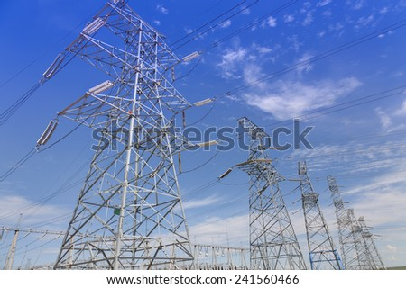 Electrical transmission tower under clear sky - stock photo