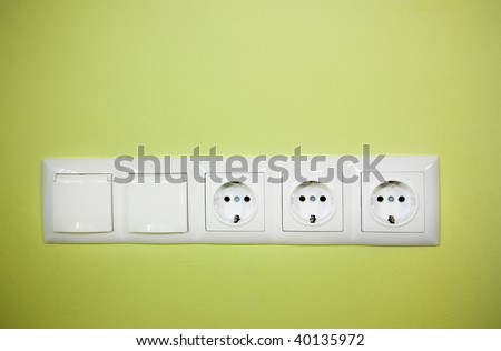 Electrical wall outlet / on green background - stock photo