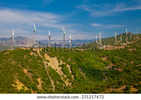 Electrical windmills system along the hill back (power production) - stock photo