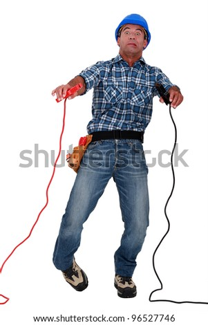 electrician being electrocuted - stock photo