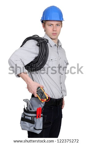 Electrician carrying a voltmeter - stock photo
