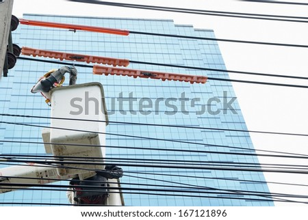 Electrician check the wiring on the car lifts  - stock photo