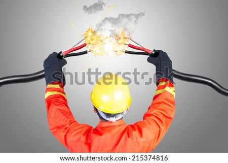 electrician connecting power cable electric shock spark during work  - stock photo