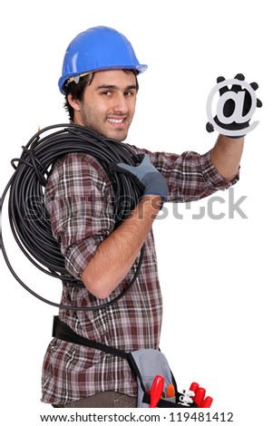 Electrician holding at symbol - stock photo